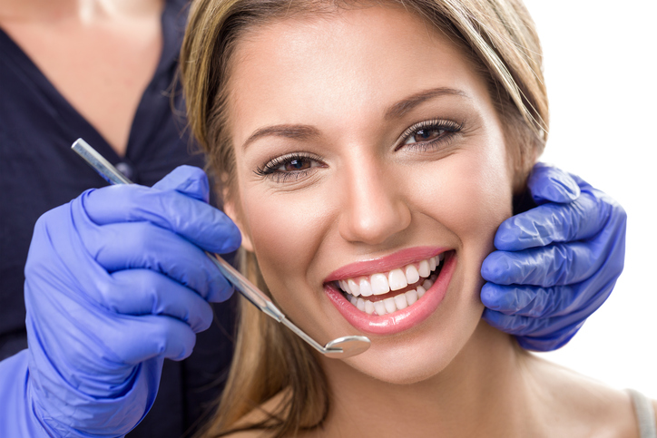 Teeth checkup at dentist, smiling woman with white teeth